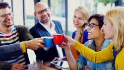 friends clinking coffee cups together